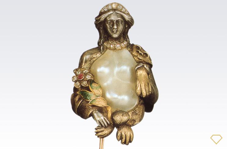 Spilla in oro con busto di perla scaramazza