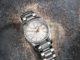Orologio Longines Conquest Classic in acciaio con diamanti appoggiato su fondale rustico