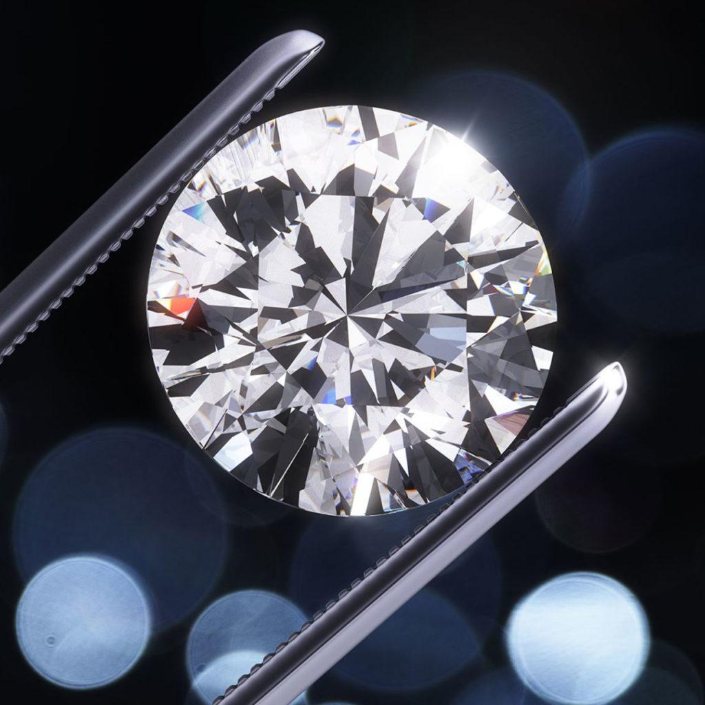 Diamante D colore tenuto con pinze da gioielliere