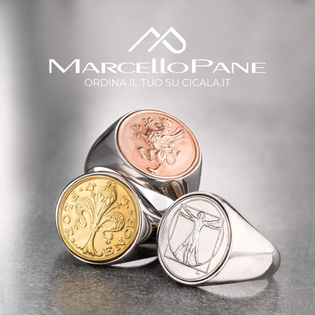 Tris di anelli chevalier di Marcello Pane raffigurante il giglio di Firenze, l'uomo di vitruvio e un grifone.